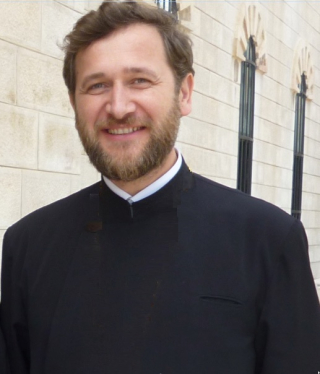 Preotul Patriciu Vlaicu.