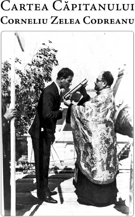 Căpitanul Corneliu Zelea Codreanu, sărutând Evanghelia.